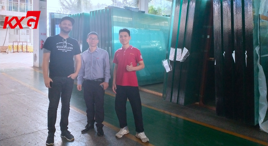 American customer visiting KXG factory float glass warehouse