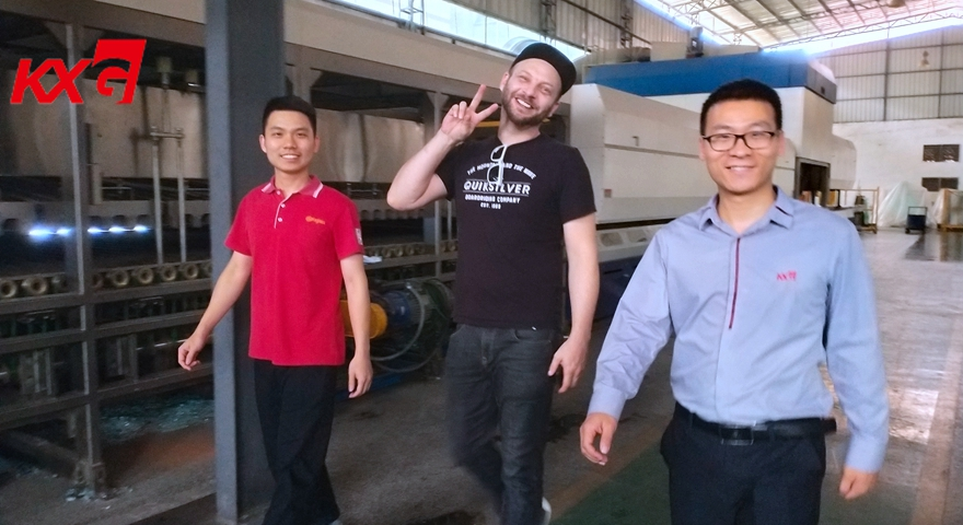 American customer visiting KXG tempered glass productin line