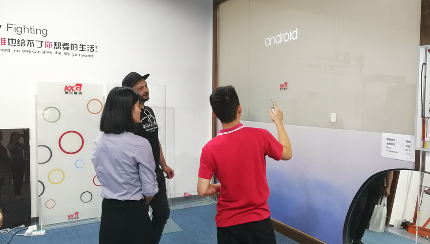 American customer visiting KXG show room smart glass