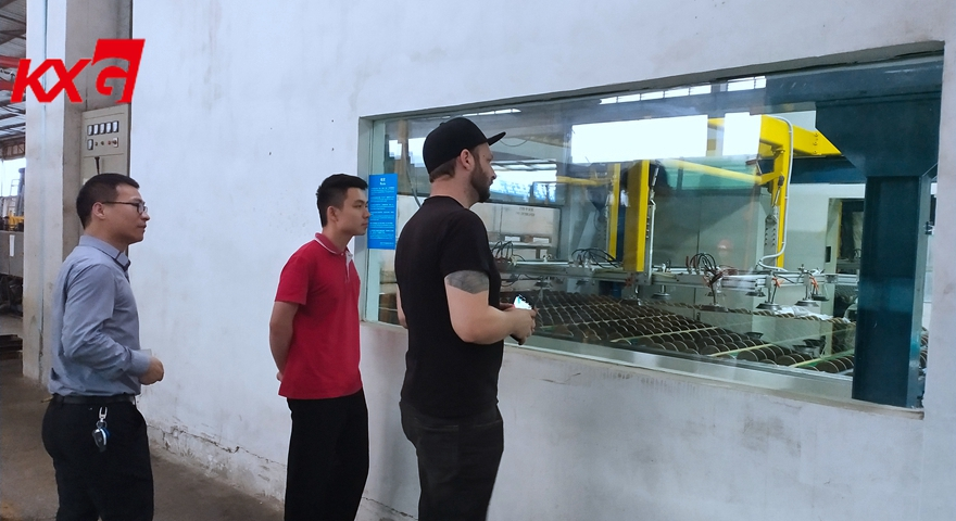 American customer watching PVB laminating glass processing outside of clear room KXG